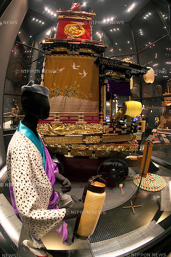 """February 14, 2013, Kawagoe, Japan - A doll wearing traditional Japanese clothes and dashi (portable shrine) at the Kawagoe Festival Museum. An old town from Edo Period (1603-1867) is located in Kawagoe, 30 minutes by train from central Tokyo. In the past Kawagoe was an important city for trade and strategic purpose, the shogun installed some of their most important loyal men as lords of Kawagoe Castle. Every year """"Kawagoe Festival"""" is held in the third weekend of October, people pull portable shrine during the parade, later """"dashi"""" floats on the streets nearby. The festival started 360 years ago supported by Nobutsuna Matsudaira, lord of Kawagoe Castle. (Photo by Rodrigo Reyes Marin/AFLO).."""