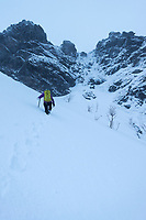 Female hikers on winter ascent of Reinebringen, Moskenesøy, Lofoten Islands, Norway