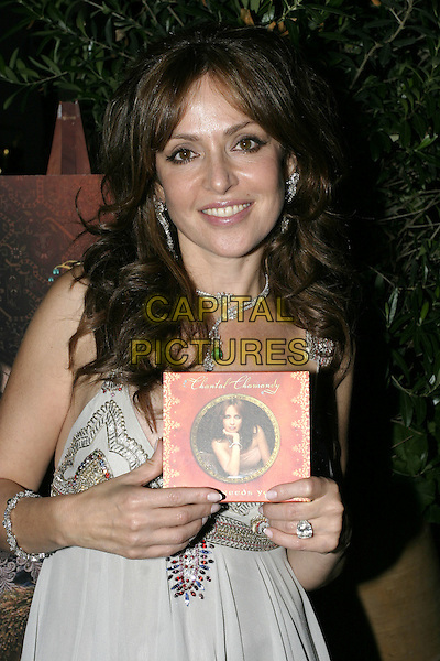 CHANTAL CHAMANDY.Attends Chantal Chamandy's Album Launch party, .Momo's Restaurant, London, July 6th 2005..half length holding cd.Ref: AH.www.capitalpictures.com.sales@capitalpictures.com.©Adam Houghton/Capital Pictures.