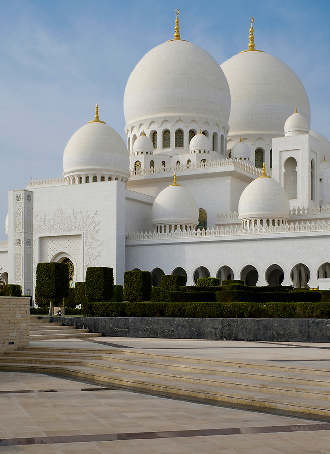 UNITED ARAB EMIRATES, ABU DHABI - CIRCA JANUARY 2017: View of the entrance,  domes and cupolas  of the Sheikh Zayed Mosque