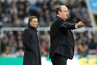 (L-R) Swansea manager Carlos Carvalhal and Newcastle manager Rafa Benitez give instructions from the touch line during the Premier League match between Newcastle United and Swansea City at St James' Park, Newcastle, England, UK. Saturday 13 January 2018