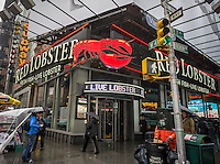 A Red Lobster restaurant in Times Square in New York is seen on Saturday, February 23, 2013. Darden Restaurants, which owns Red Lobster, also runs the Olive Garden, Longhorn Steakhouses and other casual dining brands, has cut its 3rd quarter profit forecast to below Wall Street expectations. Casual dining establishments have been suffering as diners take to lower cost alternatives.  (© Richard B. Levine)
