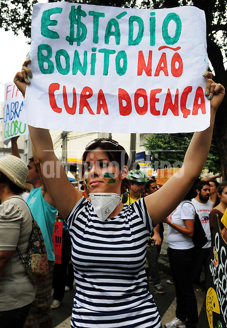A demonstrator participates in a protest in Rio de Janeiro, Brazil, 30 June, 2013. Around 4,000 people gathered to denounce corruption, poor public services despite a heavy tax burden, and also the billions of dollars spent to host the World Cup and the 2016 Olympics in Rio - money they say should be going toward better hospitals, schools, transportation projects and schools. (Austral Foto/Renzo Gostoli)