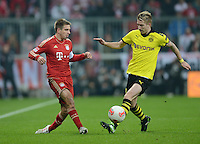 FUSSBALL   1. BUNDESLIGA  SAISON 2012/2013   15. Spieltag FC Bayern Muenchen - Borussia Dortmund     01.12.2012 Philipp Lahm (li, FC Bayern Muenchen) gegen Marco Reuss (Borussia Dortmund)