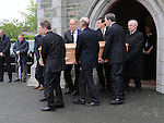 Pádraig Faulkner's brothers Bartle, Tom and Pat along with family members  carry his coffin from St Brigid's church Dunleer. Photo: Colin Bell/pressphotos.ie