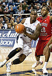 January 21, 2012:   Nevada Wolf Pack guard Malik Story looks to pass against Fresno State Bulldogs guard Garrett Johnson in the first half during their NCAA game played at Lawlor Events Center in Reno, NV.