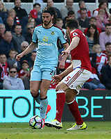 Burnley's George Boyd tries to find a way past Middlesbrough's Bernardo Espinosa<br /> <br /> Photographer David Shipman/CameraSport<br /> <br /> The Premier League - Middlesbrough v Burnley - Saturday 8th April 2017 - Riverside Stadium - Middlesbrough<br /> <br /> World Copyright &copy; 2017 CameraSport. All rights reserved. 43 Linden Ave. Countesthorpe. Leicester. England. LE8 5PG - Tel: +44 (0) 116 277 4147 - admin@camerasport.com - www.camerasport.com