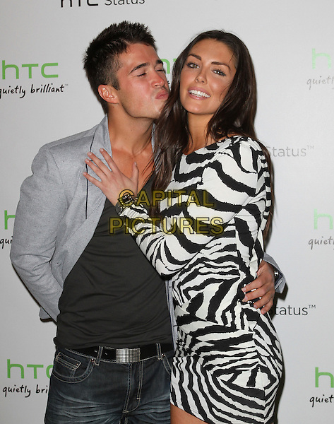 Joey Orr & Taylor Cole.The HTC Statusª Social Launch Event held at Paramount Studios in Hollywood, California, USA..July 19th, 2011.half length dress sleeve black white animal zebra print long sleeves puckering lips funny kiss kissing jacket grey gray.CAP/ADM/KB.©Kevan Brooks/AdMedia/Capital Pictures.