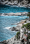 The rocky coastline on the Isle of Capri off the coast of Naples in the Campania region of Italy.