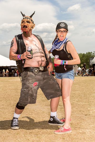 May 8, 2016. Concord, North Carolina. <br />  Fan portraits, Brad Bewick and friend.<br />  The 2016 Carolina Rebellion was held over May 6-8 next to the Charlotte Motor Speedway and featured over 50 bands including headliners Lynyrd Skynyrd, The Scorpions, Five Finger Death Punch, Disturbed, and Rob Zombie.