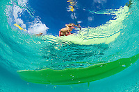 Looking up through clear water at <br /> kayakers at Honeymoon Beach<br /> Virgin Islands National Park<br /> St. John, U.S. Virgin Islands