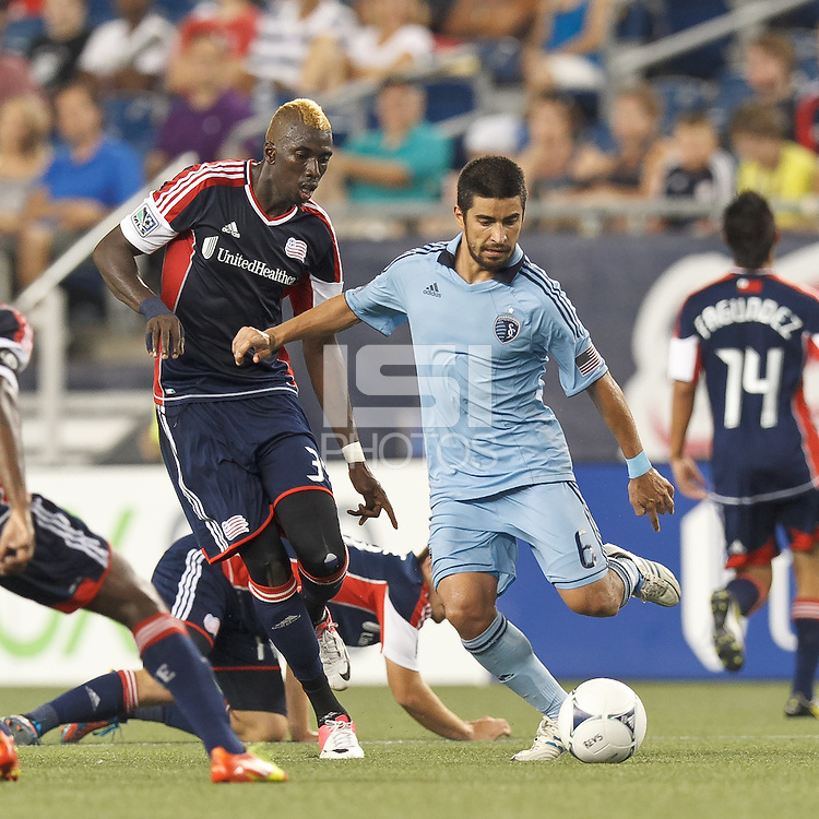 Sporting Kansas City midfielder Paulo Nagamura (6) passes the ball as New England Revolution forward Saer Sene (39) closes. In a Major League Soccer (MLS) match, Sporting Kansas City defeated the New England Revolution, 1-0, at Gillette Stadium on August 4, 2012.