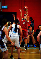 Action from the 2017 A Girls' Secondary Schools Basketball Premiership National Championship match between Hillmorten High School (red) and Ellesmere College (white) at the B&M Centre in Palmerston North, New Zealand on Tuesday, 3 October 2017. Photo: Dave Lintott / lintottphoto.co.nz