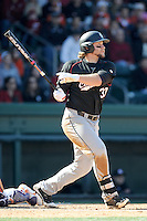 First baseman Kyle Martin (33) of the South Carolina Gamecocks drives in a run in the big third inning of the Reedy River Rivalry game against the Clemson Tigers on March 1, 2014, at Fluor Field at the West End. South Carolina won, 10-2. (Tom Priddy/Four Seam Images)