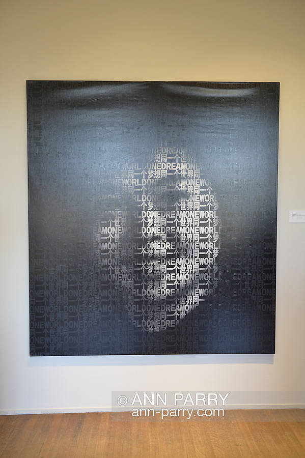 """Roslyn, New York, USA. January 2, 2015. """"Slogan A7: One World One Dream"""" (2008), acrylic on vinyl, by artist Zhang Dali (b. 1963), at the Nassau County Museum of Art China Now and Then Exhibit. Photo of Smiling girl can be seen when viewing artwork from distance."""