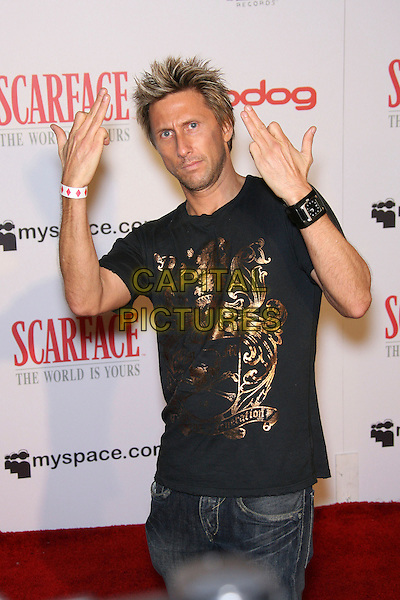 """JIM DAVIS.""""Scarface: The World Is Yours"""" Game Premiere Party held at The Vanguard.  .May 10th, 2006.Photo: Zach Lipp/AdMedia/Capital Pictures.Ref: ZL/ADM.half length hand gesture black tee shirt.www.capitalpictures.com.sales@capitalpictures.com.© Capital Pictures."""