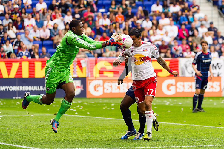 Chicago Fire goalkeeper Sean Johnson (25) takes the ball away from Tim Cahill (17) of the New York Red Bulls . The Chicago Fire defeated the New York Red Bulls 2-0 during a Major League Soccer (MLS) match at Red Bull Arena in Harrison, NJ, on October 06, 2012.