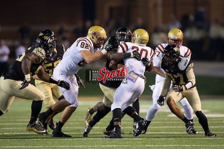 Malcolm Summers (30) of the Elon Phoenix is wrapped up by Jaboree Williams (39) of the Wake Forest Demon Deacons during second half action at BB&T Field on September 3, 2015 in Winston-Salem, North Carolina.  The Demon Deacons defeated the Elon Phoenix 41-3.   (Brian Westerholt/Sports On Film)
