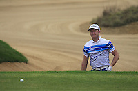 Jamie Donaldson (WAL) chips from a bunker at the 4th green during Saturay's Round 3 of the 2014 BMW Masters held at Lake Malaren, Shanghai, China. 1st November 2014.<br /> Picture: Eoin Clarke www.golffile.ie