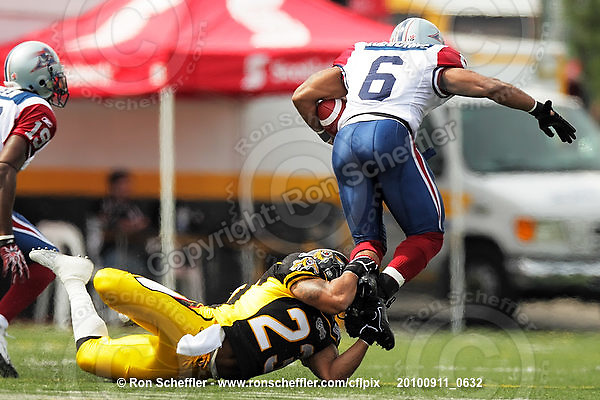 September 11, 2010; Hamilton, ON, CAN; Hamilton Tiger-Cats defensive back Will Heyward (23) tackles Montreal Alouettes running back Avon Cobourne (6). CFL football: Montreal Alouettes vs. Hamilton Tiger-Cats at Ivor Wynne Stadium. The Alouettes defeated the Tiger-Cats 27-6. Mandatory Credit: Ron Scheffler. Copyright (c) 2010 Ron Scheffler.