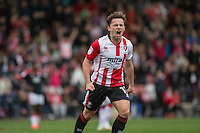 Jack Munns of Cheltenham celebrates scoring his side's second goal during the Sky Bet League 2 match between Cheltenham Town and Crawley Town at the LCI Rail Stadium, Cheltenham, England on 15 October 2016. Photo by Mark  Hawkins.