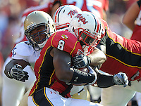 Davin Meggett of Terrapins is brought down by a Midshipmen defender. Maryland defeated Navy 17-14 at the M&T Bank in Baltimore, MD on Monday, September 6, 2010. Alan P. Santos/DC Sports Box
