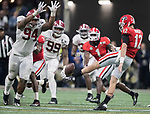 Alabama Crimson Tide defensive lineman Da'Ron Payne (94) attempts to block the punt of Georgia Bulldog's Brice Ramsey (12) in the fourth quarter of the NCAA College Football Playoff National Championship at Mercedes-Benz Stadium on January 8, 2018 in Atlanta. Photo by Mark Wallheiser/UPI