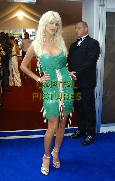 VICTORIA SILVERSTEDT.Glamour Magazine's Women Of The Year Awards. Berkeley Square Gardens, London, W1.June 8th, 2004.full length, full-length, hand on hip, green dress, tassles.www.capitalpictures.com.sales@capitalpictures.com.©Capital Pictures