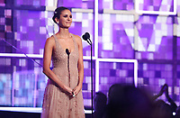 Nina Dobrev introduces a performance at the 61st annual Grammy Awards on Sunday, Feb. 10, 2019, in Los Angeles. (Photo by Matt Sayles/Invision/AP)