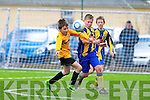 Eoin Clifford Killorglin AFC powers past Clonmel's Sam Dwyer during their National Cup QF in Killorglin on Saturday