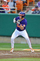 Clemson Tigers second baseman Steve Wilkerson #17 squares to bunt during a game against the Florida State Seminoles at Doug Kingsmore Stadium on March 22, 2014 in Clemson, South Carolina. The Seminoles defeated the Tigers 4-3. (Tony Farlow/Four Seam Images)