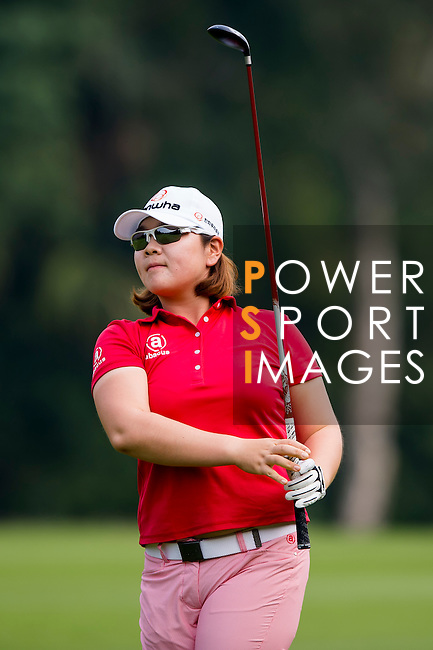 Min-Young Lee of Korea in action during the Hyundai China Ladies Open 2014 on December 10 2014 at Mission Hills Shenzhen, in Shenzhen, China. Photo by Li Man Yuen / Power Sport Images