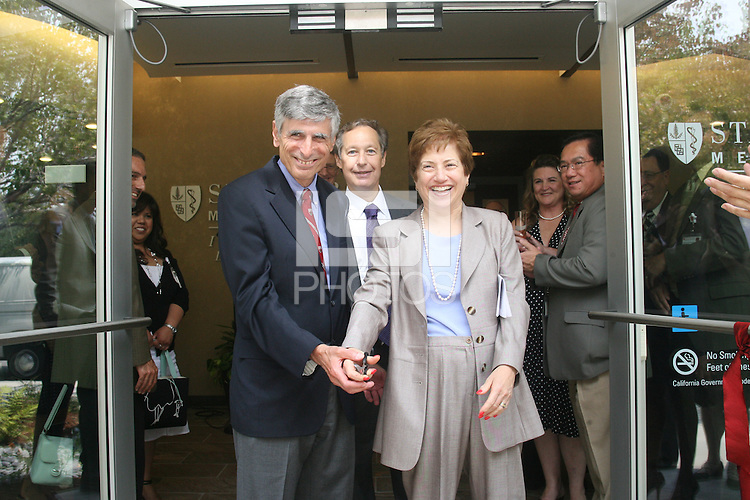 STANFORD, CA - June 27:  Photos of the ribbon cutting during the Stanford Medicine Radiology Outpatient Imaging Center grand opening on Sherman Ave. on June 27, 2008 in Palo Alto, California. Pictured are President and CEO of Stanford Hospital Martha Marsh (r) and the Carl and Elizabeth Naumann<br />