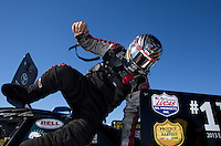 Sept. 22, 2013; Ennis, TX, USA: NHRA funny car driver Cruz Pedregon climbs from his car after winning the Fall Nationals at the Texas Motorplex. Mandatory Credit: Mark J. Rebilas-