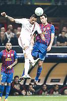 MILANO 28 MARZO 2012, MILAN - BARCELLONA,QUARTI DI FINALE UEFA CHAMPIONS LEAGUE 2011 - 2012, NELLA FOTO:BOATENG - BUSQUETS , FOTO DI ROBERTO TOGNONI.