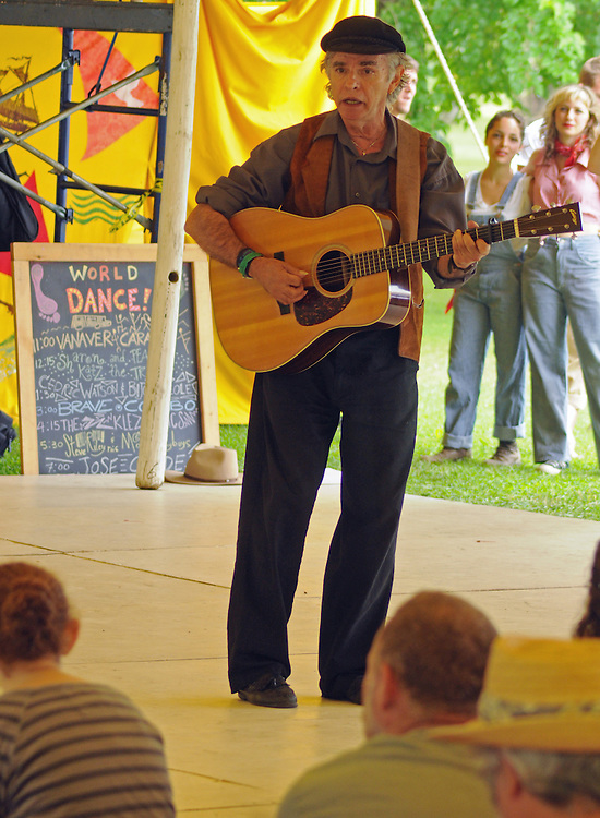 "Bill Vanaver, singing the introduction of the Vanaver Caravan's performance of, ""Pastures of Plenty: Tribute to Woody Guthrie"" on the Dance Stage of the 2012 Clearwater Festival at Croton Point Park on Sunday, June 17, 2012. Photograph taken by Jim Peppler. Copyright Jim Peppler/2012."