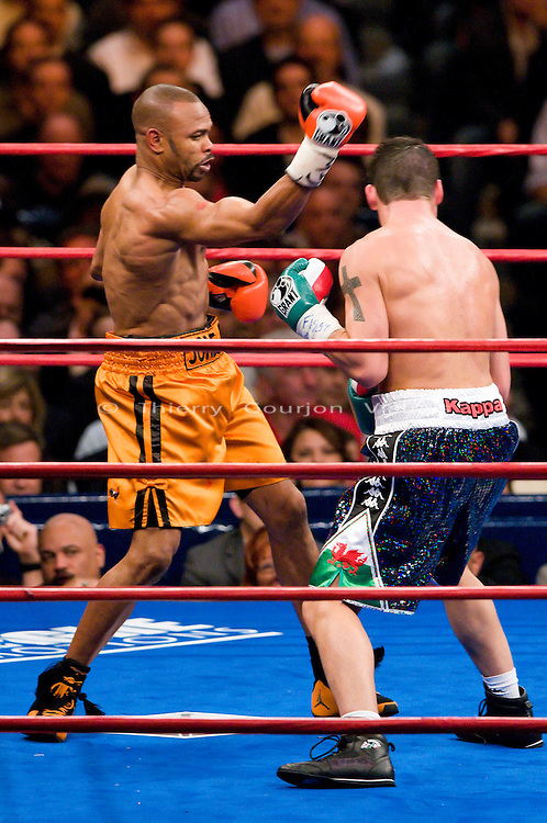 New York, Nov. 10th, 2008: Roy Jones Jr. on the attack against  Joe Calzaghe (black trunk) during their Ring Magazine Light Heavyweight Championship fight at  Madison Square Garden. Calzaghe won by unanimous decision. Photo by Thierry Gourjon.