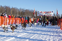 Jeremiah Klejka leaves the start line of the Junior Iditarod  at Knik Lake, Knik, Alaska