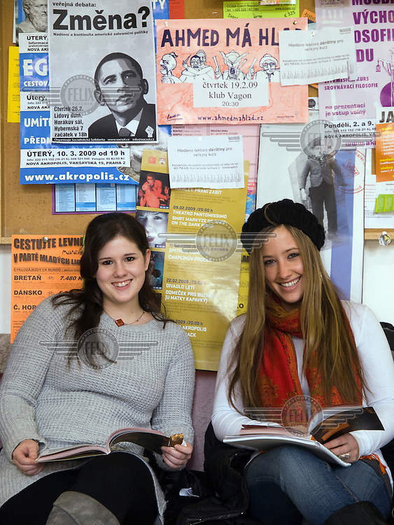 Erasmus students of the philosophy faculty of Charles University. Left Laura Gurfein and Jordana Molloy - both are guest students from New York, USA. A poster featuring US President Barack Obama is pinned up on the wall behind them.