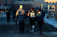Uncle Tom Mahlum (l), Cody and ladyfriend walk away from the stadium. Tom started Cody in the Bobcats path; how fiitting that he got to walk with Cody at the end of his illustrious football career.