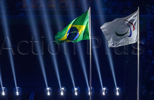 07.9.2016. Rio de Janeiro, Brazil.  The flags of the Paralympics (R) and the Brazilian flag (L) seen during the Opening Ceremony during the Opening Ceremony of the Rio 2016 Paralympic Games, Rio de Janeiro, Brazil, 07 September 2016.