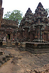 Angkorian temple Banteay Srei (late 10th century) 967.<br /> Doorway on right into northern tower sanctuary.Open doorway into Mandapa at centre and part of northern library to left.<br /> Three sanctuary towers.The central sanctuary and the southern sanctuary were dedicated to Shiva and the northern sanctuary was dedicated to Vishnu.<br /> Banteay Srei temple is situated 20km north of Angkor, built during the reign of Rajendravarman by Yajnavaraha, one of his counsellors. In antiquity Isvarapura was a small city that grew up around the temple. Banteay Srei was dedicated to the worship of Shiva, the foundation stele describes the consecration of the linga Tribhuvanamahesvara (Lord of the three worlds) in 967.