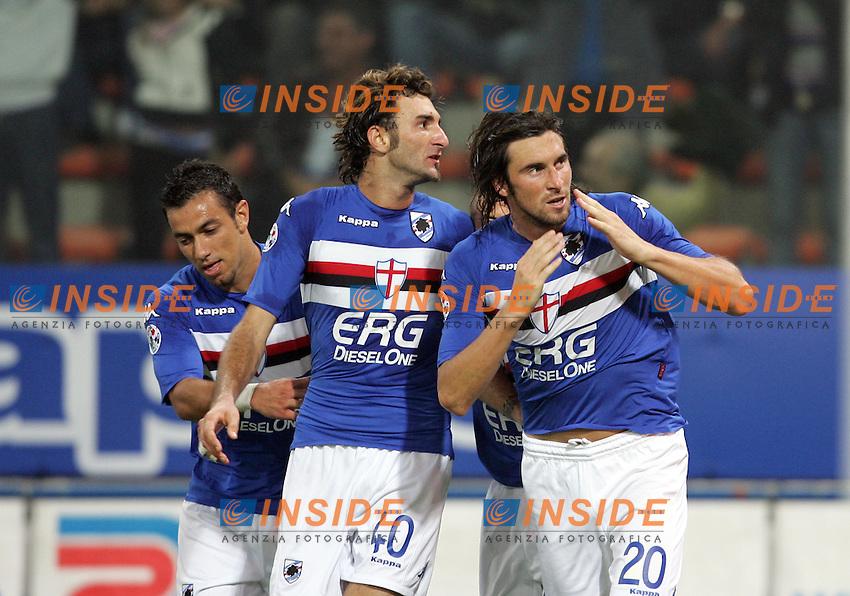 Emiliano Bonazzoli (R) (Sampdoria) celebrates after scoring with teammates Gennaro Delvecchio (C) and Fabio Quagliarella (L). Emiliano Bonazzoli festeggia il gol con Gennaro Delvecchio e Fabio Quagliarella<br /> Italian &quot;Serie A&quot; 2006-2007<br /> 14 Oct 2006 (match day 6)<br /> Sampdoria - Milan (1-1)<br /> &quot;Luigi Ferraris&quot; Stadium - Genova - Italy<br /> Photographer: Andrea Staccioli Inside