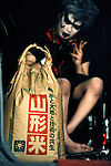 A wrestler eyes the prize at ringside -- a 20 kg bag of rice -- during Doglegs, an event for wrestlers with physical and metal handicaps in Tokyo, Japan.