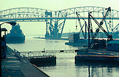 M/V Louis R Desmarais waits for the Soo Locks to open for down bound trip with the International Bridge in the background.
