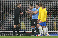 Luis Suarez of Uruguay speaks to Craig Pawson, after the referee awarded Brazil a penalty during Brazil vs Uruguay, International Friendly Match Football at the Emirates Stadium on 16th November 2018