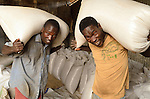 In northern Uganda, the cotton ginnery at Gulu Agricultural Development Company has experienced rapid growth in an impoverished, war-weary, subsistence-farming region that has been desperate for sustainable economic development. The Gulu cotton eneterprise was begun only three years ago, following the ouster of Joseph Kony's Lord's Resistance Army (LRA) and new regional peace. South African entrepreneur Bruce Robertson undertook the business, seeking to build on his successful cotton gin operations in western Uganda. I photographed for the Acumen Fund, which is providing Gulu Cotton with bridge crop loans. Photos 1-161 are people and operations at the Gulu Cotton Ginnery. #162-218 are farmers in their fields or at home.