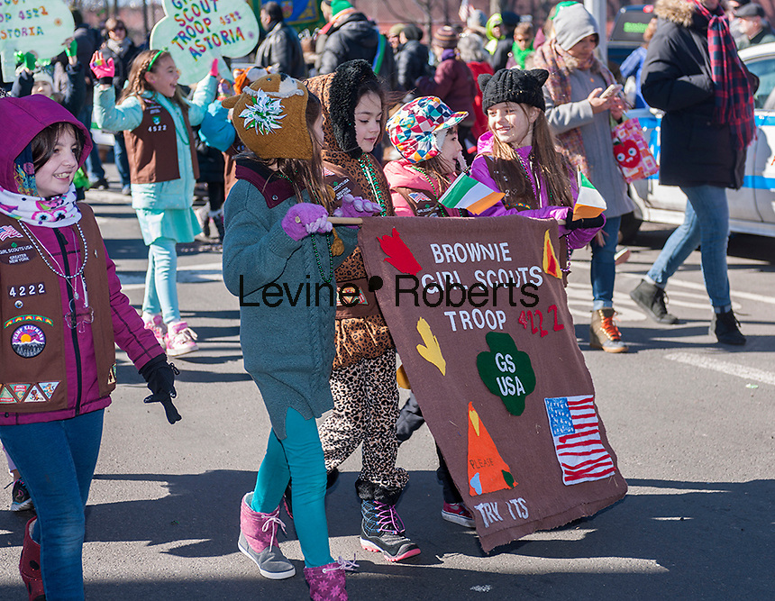 """Local Girl Scout troops march in the Sunnyside, Queens St. Patrick's Parade on March 5, 2017. Billed as """"St. Pat's For All"""" the festive event started as an alternative to the New York parade, and organizers have endeavored to make the parade inclusive allowing gays and lesbians to march who were banned from the New York parade. (© Richard B. Levine)"""