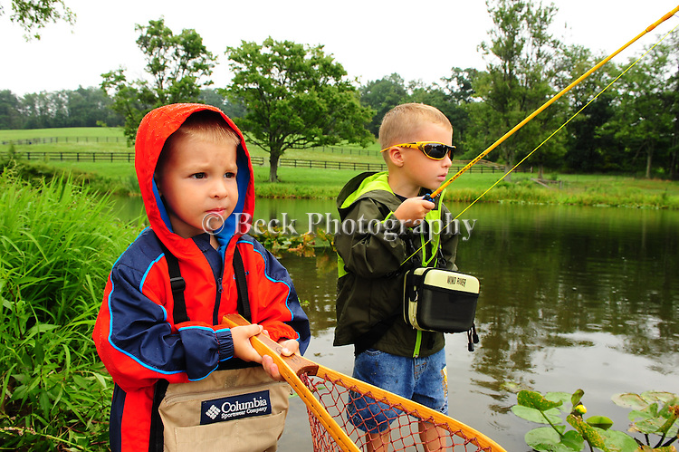 Two brothers, fishing in a pond in northeast PA