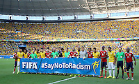 Both teams and the officials pose with the FIFA Say no to racism banner